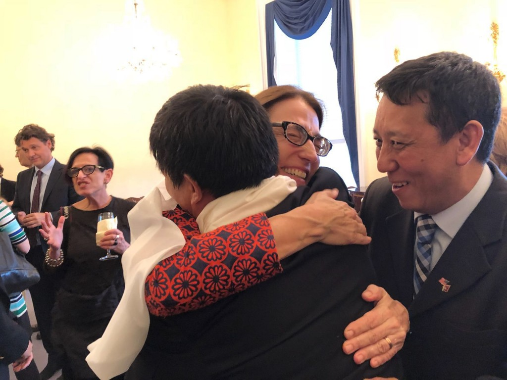 Sarah Sewall hugging Dhondup Wangchen, right Jamyang Tsultrim